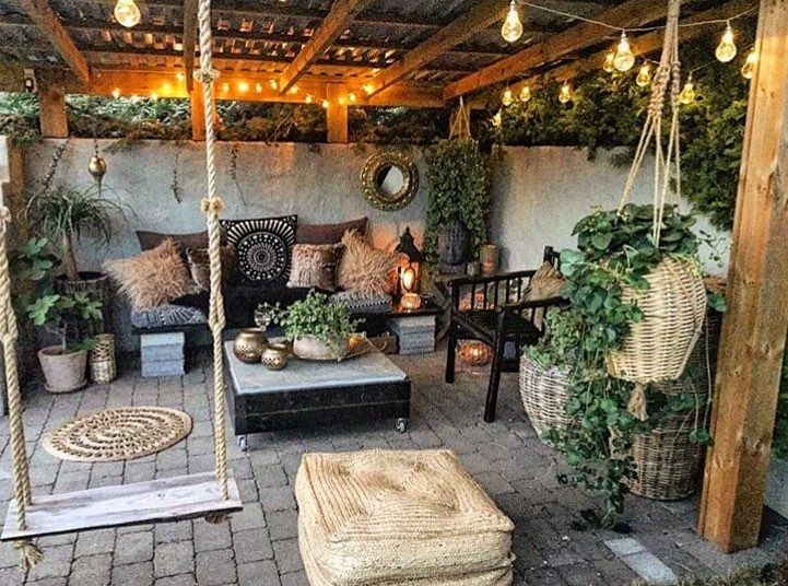 Picturesque outdoor patio with cosy furnishings and plants